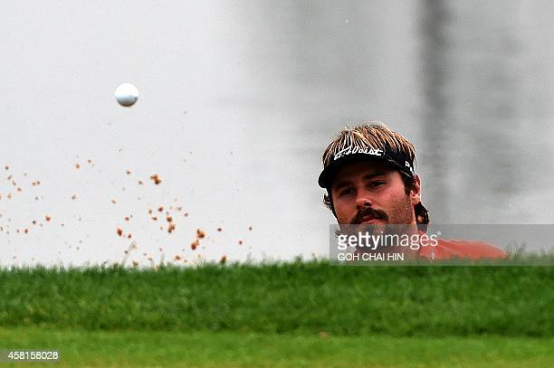 Victor Dubuisson of France watches as his chip shot fails to land on the green during the second day of the BMW Shanghai Masters golf tournament at...