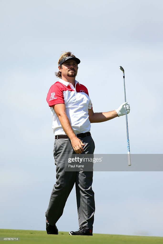 <a gi-track='captionPersonalityLinkClicked' href=/galleries/search?phrase=Victor+Dubuisson&family=editorial&specificpeople=3333395 ng-click='$event.stopPropagation()'>Victor Dubuisson</a> of France watches his second shot on the 18th hole during day four of the 2014 Perth International at Lake Karrinyup Country Club on October 26, 2014 in Perth, Australia.
