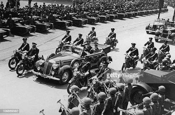 Victor Emanuel III King of Italy and Adolf Hitler in a car heading a column at the Mergellina Station Naples Italy Photograph April 26 1939