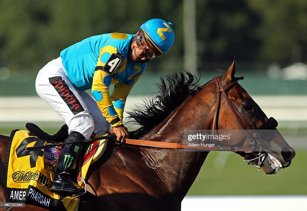 Victor Espinoza atop American Pharoah reacts after winning the 48th William Hill Haskell Invitational at Monmouth Park on August 2 2015 in Monmouth...