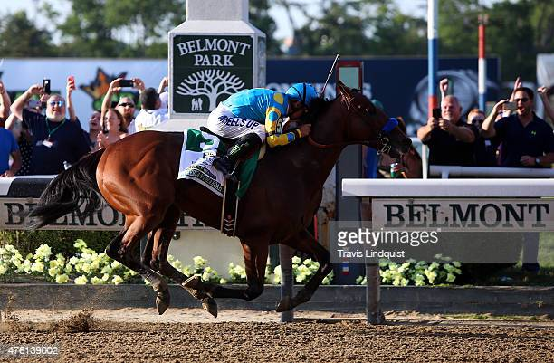 Victor Espinoza celebrates atop American Pharoah after winning the 147th running of the Belmont Stakes at Belmont Park on June 6 2015 in Elmont New...