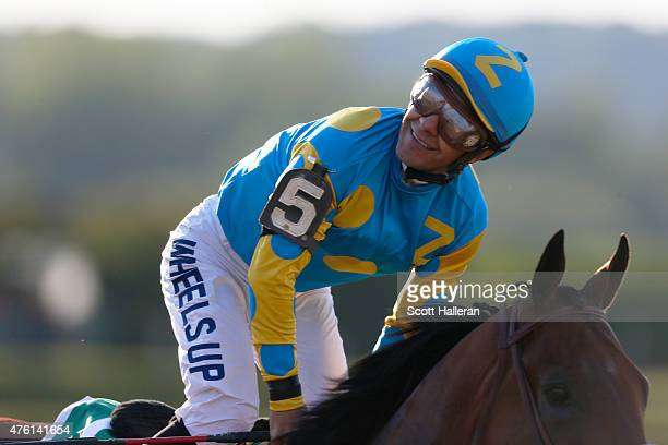 Victor Espinoza celebrates atop American Pharoah in the winner's circle after winning the 147th running of the Belmont Stakes at Belmont Park on June...