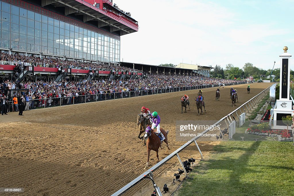 Victor Espinoza celebrates atop California Chrome after winning the 139th running of the Preakness Stakes at Pimlico Race Course on May 17 2014 in...