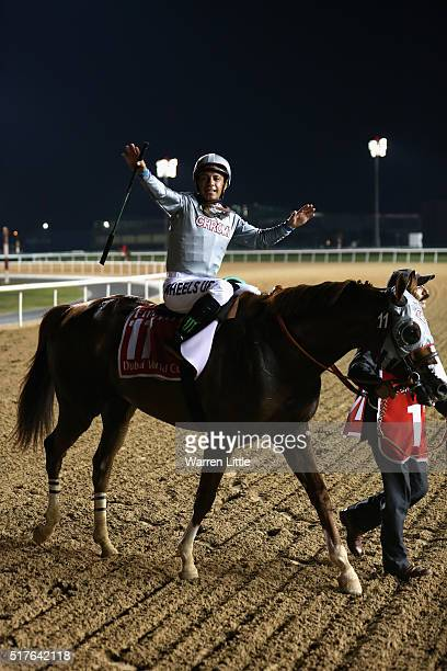 Victor Espinoza celebrates riding California Chrome to victory in the Dubai World Cup Sponsored By Emirates Airline as part of the duirng the Dubai...