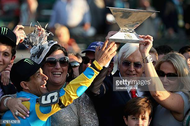 Victor Espinoza jockey of American Pharaoh and trainer Bob Baffert celebrate with the Triple Crown Trophy after winning the 147th running of the...