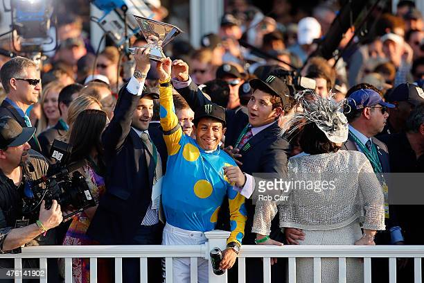 Victor Espinoza jockey of American Pharoah celebrates with the Triple Crown Trophy after winning the 147th running of the Belmont Stakes at Belmont...