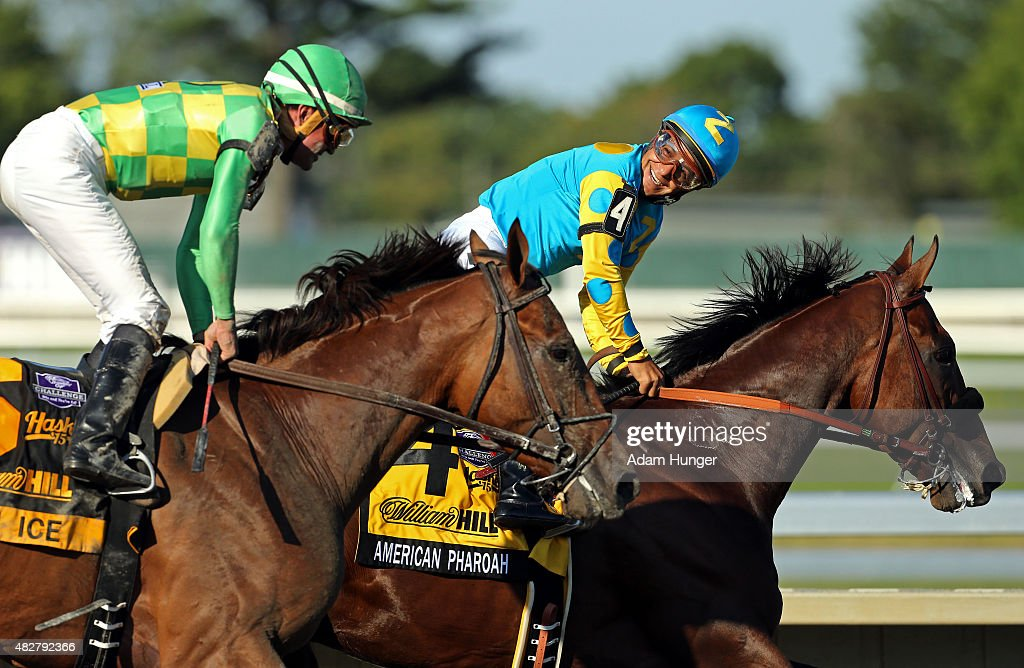 Victor Espinoza rides atop American Pharoah after winning the 48th William Hill Haskell Invitational looks back at second place finisher Kent...