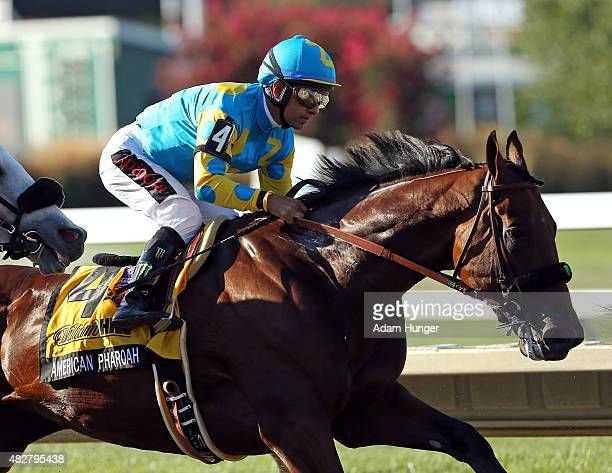 Victor Espinoza rides atop American Pharoah during the 48th William Hill Haskell Invitational at Monmouth Park on August 2 2015 in Monmouth New Jersey