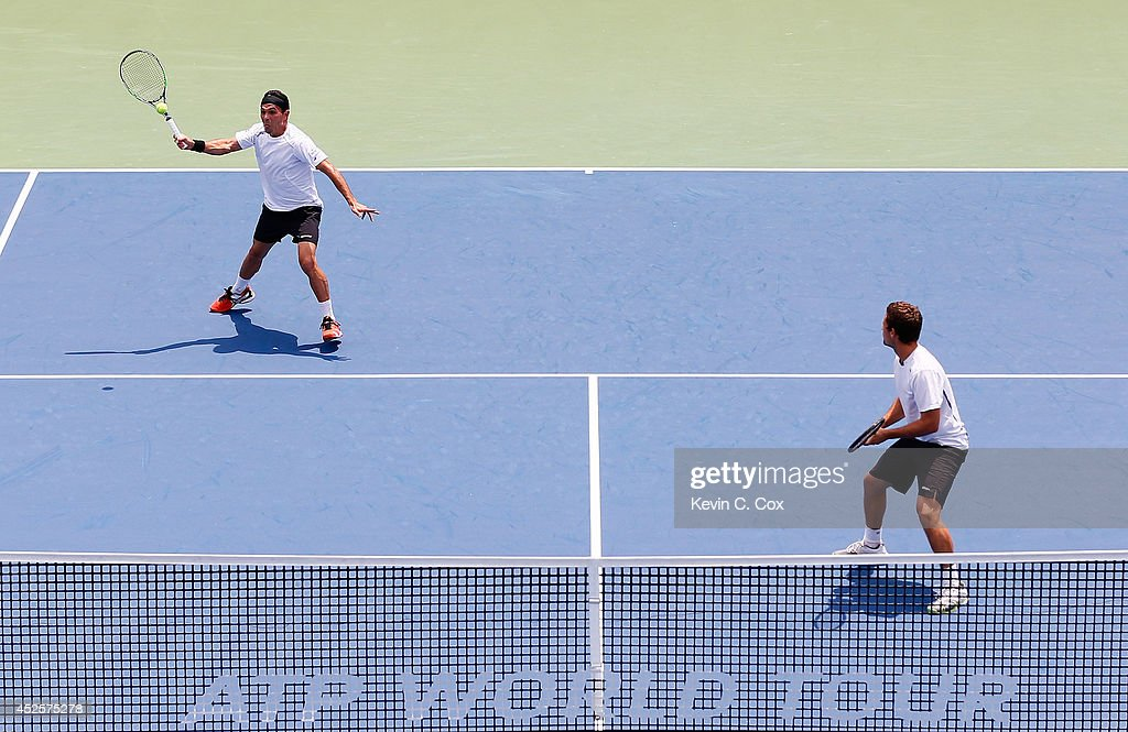 Victor Estrella Burgos of the Dominican Republic and Nicolas Barrientos of Colombia return a shot against Sanchai and Sonchat Ratiwatana of Thailand during the BB&T Atlanta Open at Atlantic Station on July 23, 2014 in Atlanta, Georgia.
