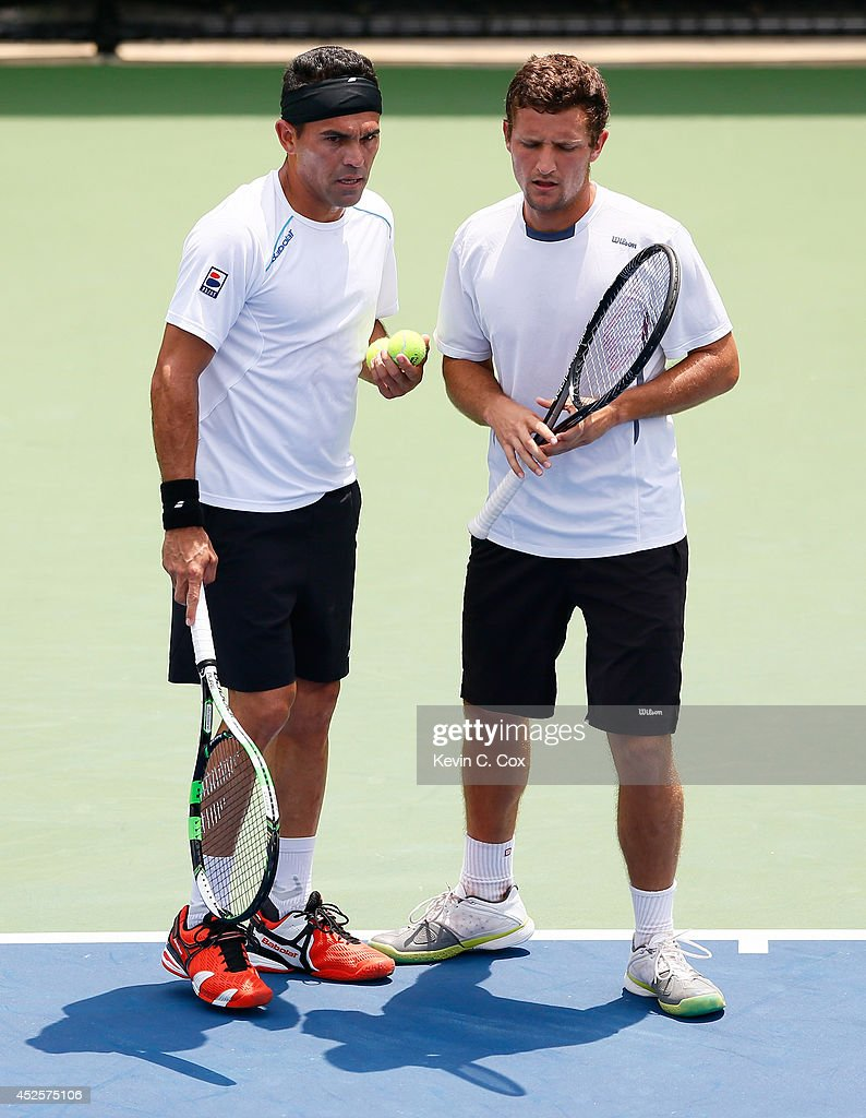 Victor Estrella Burgos of the Dominican Republic and Nicolas Barrientos of Colombia converse during their match against Sanchai and Sonchat Ratiwatana of Thailand at the BB&T Atlanta Open at Atlantic Station on July 23, 2014 in Atlanta, Georgia.