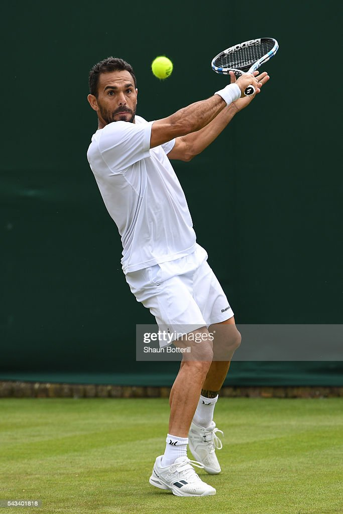 <a gi-track='captionPersonalityLinkClicked' href=/galleries/search?phrase=Marcel+Granollers&family=editorial&specificpeople=14432149 ng-click='$event.stopPropagation()'>Marcel Granollers</a> of Spain plays a backhand during the Men's Singles first round match against Victor Estrella Burgos of Dominican Republic on day two of the Wimbledon Lawn Tennis Championships at the All England Lawn Tennis and Croquet Club on June 28, 2016 in London, England.