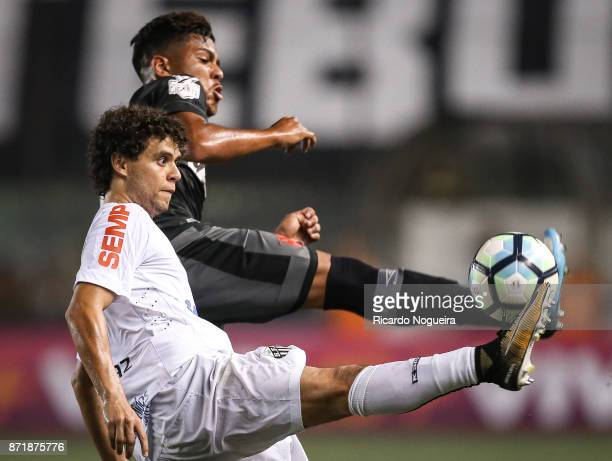 Victor Ferraz of Santos battles for the ball with Evander of Vasco during the match between Santos and Vasco da Gama as a part of Campeonato...