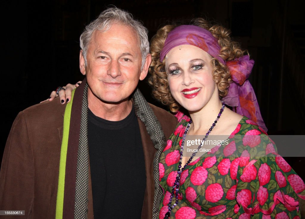 Victor Garber and Katie Finneran as 'Miss Hannigan' pose backstage at the hit revival of 'Annie' on Broadway at The Palace Theater on November 2, 2012 in New York City.