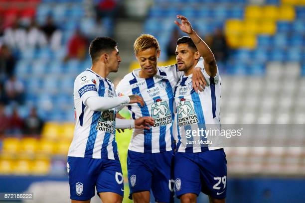 Victor Guzman Keisuke Honda and Franco Jara of Pachuca celebrate their team's first goal during the quarter final match between Pachuca and Tijuana...