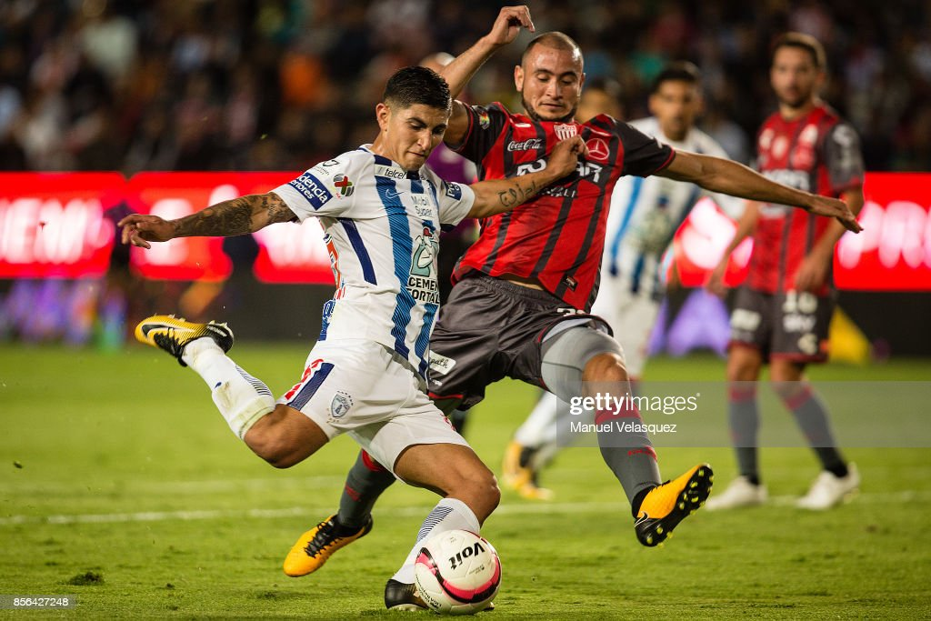 Victor Guzman (L) of Pachuca struggles for the ball with Facundo Pereyra (R) of Necaxa during the 12th round match between Pachuca and Necaxa as part of the Torneo Apertura 2017 Liga MX at Hidalgo Stadium on September 30, 2017 in Pachuca, Mexico.