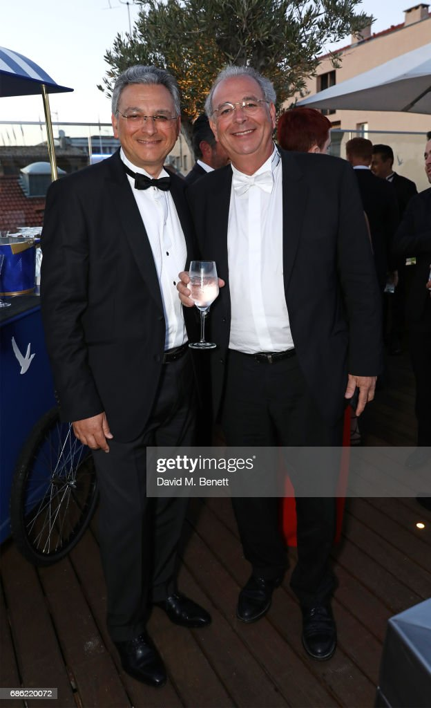 Victor Hadida (L) and Samuel Hadida attend The Weinstein Company pre-reception of 'Wind River' in association with Grey Goose Vodka, de Grisogono, and Hotel de Crillon during the Cannes Film Festival 2017 on May 20, 2017 in Cannes, France.