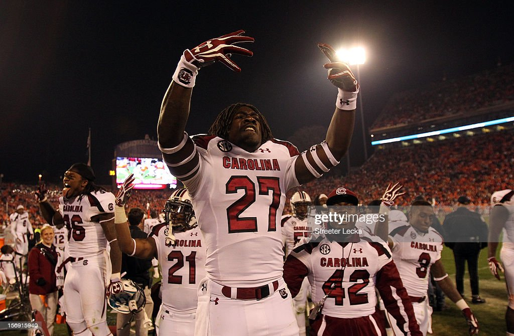 Victor Hampton #27 of the South Carolina Gamecocks celebrates after defeating the Clemson Tigers 27-17 after their game at Memorial Stadium on November 24, 2012 in Clemson, South Carolina.