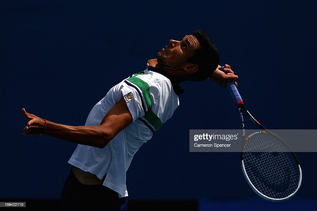 Victor Hanescu of Romania serves in his first round match against Kei Nishikori of Japan during day one of the 2013 Australian Open at Melbourne Park on January 14, 2013 in Melbourne, Australia.