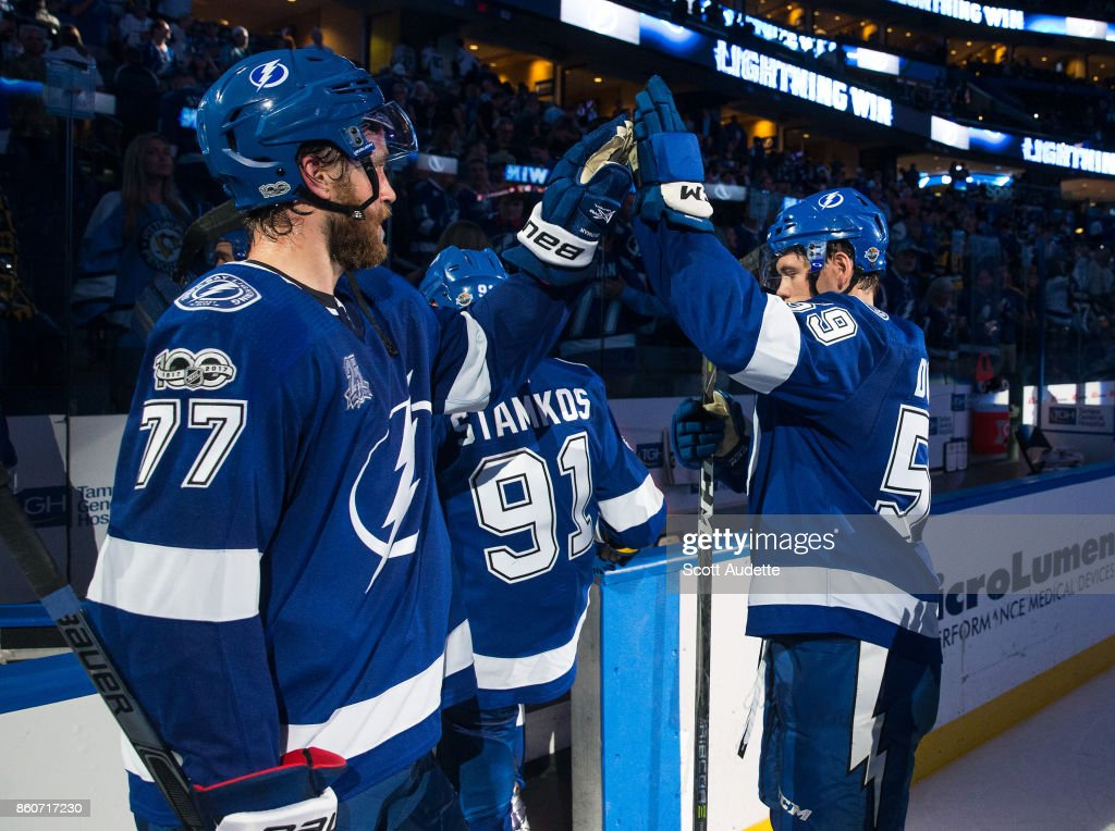 Victor Hedman #77 and Jake Dotchin #59 of the Tampa Bay Lightning celebrate the win against the Pittsburgh Penguins at Amalie Arena on October 12, 2017 in Tampa, Florida.