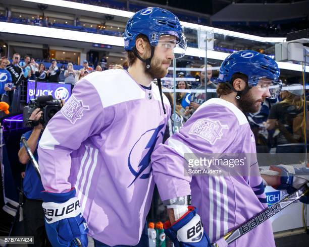 Victor Hedman and Nikita Kucherov of the Tampa Bay Lightning skates against the New York Rangers during the pregame warm ups at Amalie Arena on...