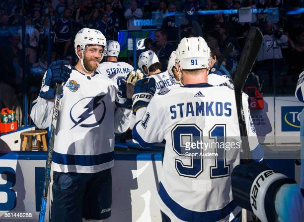 Victor Hedman and Steven Stamkos of the Tampa Bay Lightning celebrate the win against the St Louis Blues at Amalie Arena on October 14 2017 in Tampa...