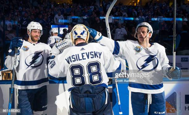 Victor Hedman goalie Andrei Vasilevskiy and Jake Dotchin of the Tampa Bay Lightning celebrate the win against the St Louis Blues at Amalie Arena on...