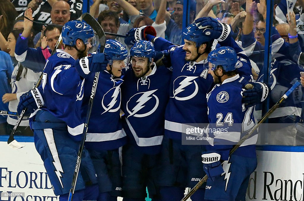 Victor Hedman #77, Matt Carle #25,Cedric Paquette #13 and Ryan Callahan #24 celebrate a goal by Brian Boyle #11 of the Tampa Bay Lightning against the New York Islanders during the first period of Game Five of the Eastern Conference Second Round during the 2016 NHL Stanley Cup Playoffs at Amalie Arena on May 8, 2016 in Tampa, Florida.