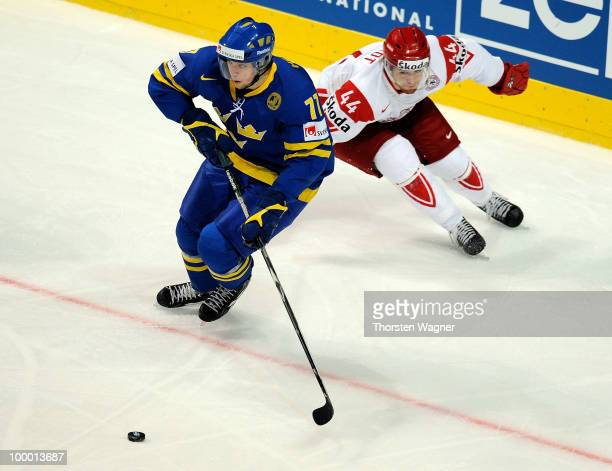 Victor Hedman of Sweden battles for the puck with Nichlas Hardt of Denmark during the IIHF World Championship quarter final match between Sweden and...