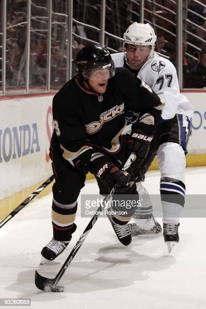 Victor Hedman of the Tampa Bay Lighting reaches in for the puck against Teemu Selanne of the Anaheim Ducks during the game on November 19 2009 at...
