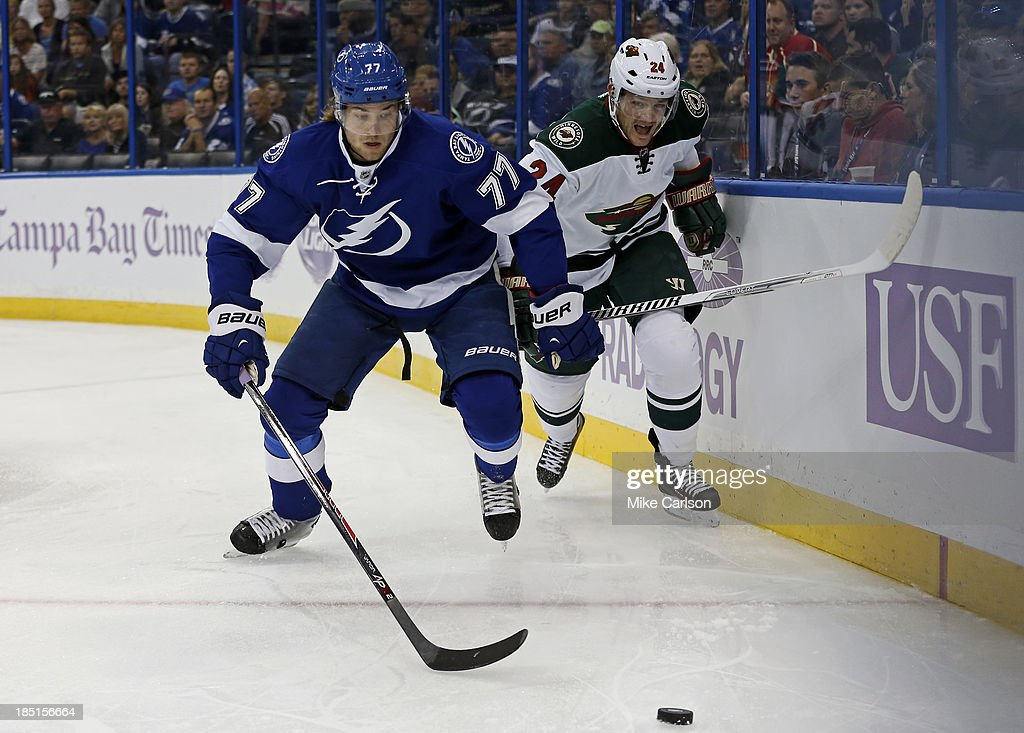 <a gi-track='captionPersonalityLinkClicked' href=/galleries/search?phrase=Victor+Hedman&family=editorial&specificpeople=4784238 ng-click='$event.stopPropagation()'>Victor Hedman</a> #77 of the Tampa Bay Lightning and <a gi-track='captionPersonalityLinkClicked' href=/galleries/search?phrase=Matt+Cooke&family=editorial&specificpeople=592551 ng-click='$event.stopPropagation()'>Matt Cooke</a> #24 of the Minnesota Wild battle for a loose puck at the Tampa Bay Times Forum on October 17, 2013 in Tampa, Florida.