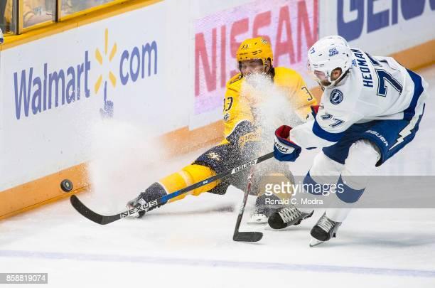 Victor Hedman of the Tampa Bay Lightning and Viktor Arvidsson of the Nashville Predators go after the puck during a NHL preseason game at Bridgestone...