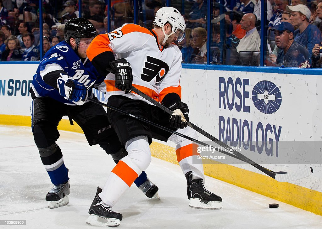 <a gi-track='captionPersonalityLinkClicked' href=/galleries/search?phrase=Victor+Hedman&family=editorial&specificpeople=4784238 ng-click='$event.stopPropagation()'>Victor Hedman</a> #77 of the Tampa Bay Lightning battles for control of the puck with a Philadelphia Flyers player during the second period of the game at the Tampa Bay Times Forum on March 18, 2013 in Tampa, Florida.