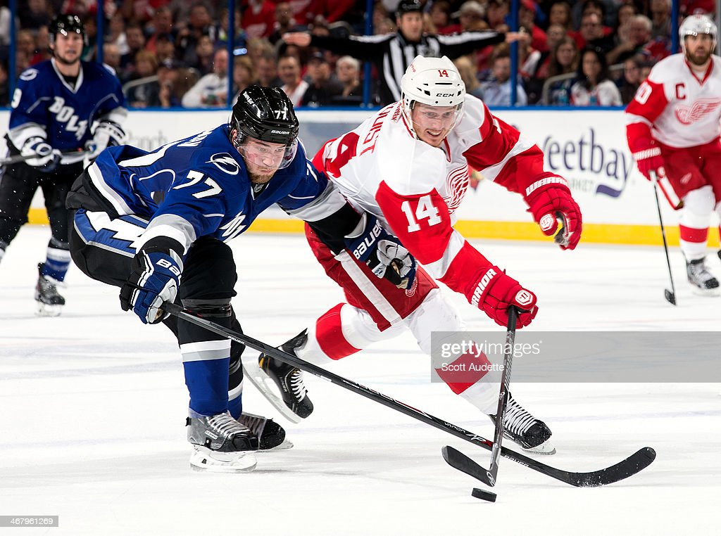 <a gi-track='captionPersonalityLinkClicked' href=/galleries/search?phrase=Victor+Hedman&family=editorial&specificpeople=4784238 ng-click='$event.stopPropagation()'>Victor Hedman</a> #77 of the Tampa Bay Lightning battles for the puck against <a gi-track='captionPersonalityLinkClicked' href=/galleries/search?phrase=Gustav+Nyquist&family=editorial&specificpeople=5491209 ng-click='$event.stopPropagation()'>Gustav Nyquist</a> #14 of the Detroit Red Wings during the third period at the Tampa Bay Times Forum on February 8, 2014 in Tampa, Florida.