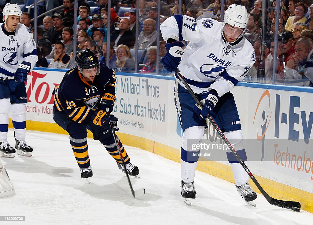 <a gi-track='captionPersonalityLinkClicked' href=/galleries/search?phrase=Victor+Hedman&family=editorial&specificpeople=4784238 ng-click='$event.stopPropagation()'>Victor Hedman</a> #77 of the Tampa Bay Lightning carries the puck along the boards in front of <a gi-track='captionPersonalityLinkClicked' href=/galleries/search?phrase=Cody+Hodgson&family=editorial&specificpeople=4151192 ng-click='$event.stopPropagation()'>Cody Hodgson</a> #19 of the Buffalo Sabres at First Niagara Center on October 8, 2013 in Buffalo, New York.
