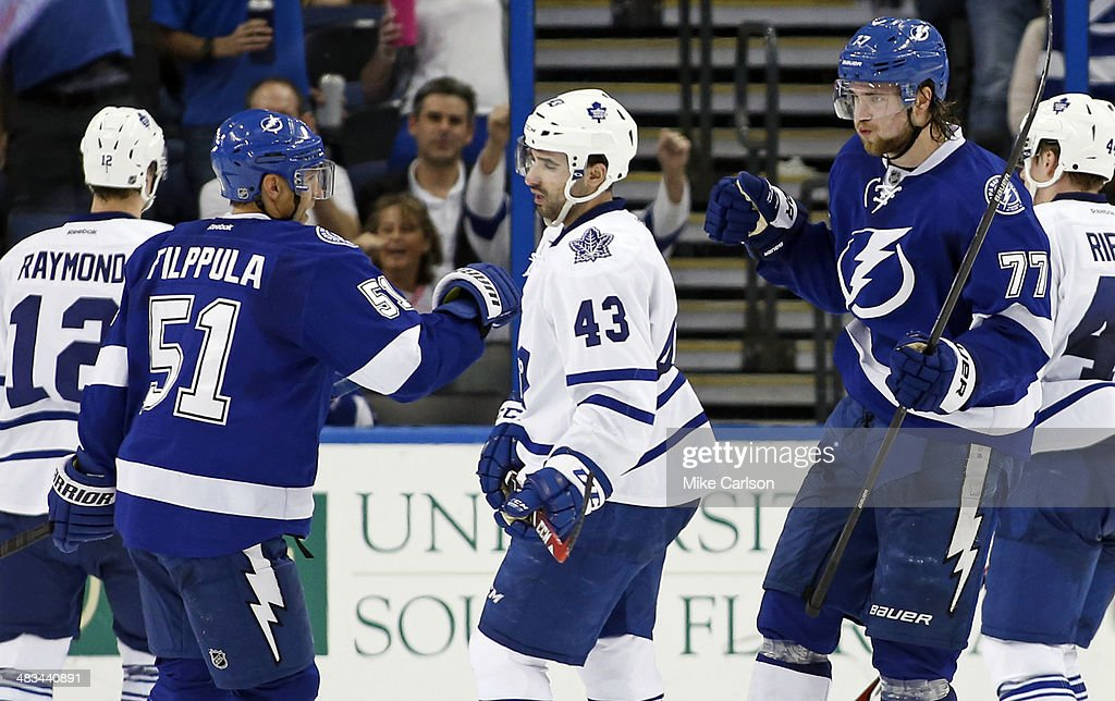 <a gi-track='captionPersonalityLinkClicked' href=/galleries/search?phrase=Victor+Hedman&family=editorial&specificpeople=4784238 ng-click='$event.stopPropagation()'>Victor Hedman</a> #77 of the Tampa Bay Lightning (R) celebrates his goal with teammate <a gi-track='captionPersonalityLinkClicked' href=/galleries/search?phrase=Valtteri+Filppula&family=editorial&specificpeople=2234404 ng-click='$event.stopPropagation()'>Valtteri Filppula</a> #51as <a gi-track='captionPersonalityLinkClicked' href=/galleries/search?phrase=Nazem+Kadri&family=editorial&specificpeople=4043234 ng-click='$event.stopPropagation()'>Nazem Kadri</a> #43 of the Toronto Maple Leafs reacts at the Tampa Bay Times Forum on April 8, 2014 in Tampa, Florida.