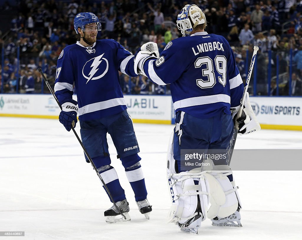 <a gi-track='captionPersonalityLinkClicked' href=/galleries/search?phrase=Victor+Hedman&family=editorial&specificpeople=4784238 ng-click='$event.stopPropagation()'>Victor Hedman</a> #77 of the Tampa Bay Lightning celebrates with goalie <a gi-track='captionPersonalityLinkClicked' href=/galleries/search?phrase=Anders+Lindback&family=editorial&specificpeople=7211274 ng-click='$event.stopPropagation()'>Anders Lindback</a> #39 after a shut out against the Toronto Maple Leafs at the Tampa Bay Times Forum on April 8, 2014 in Tampa, Florida.