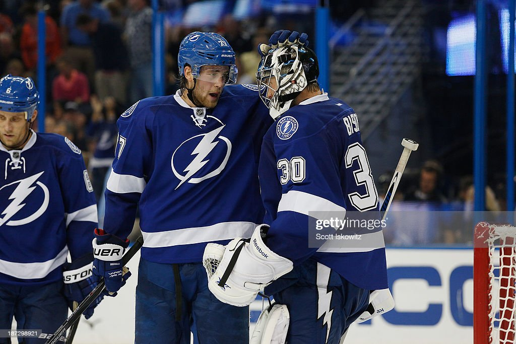 <a gi-track='captionPersonalityLinkClicked' href=/galleries/search?phrase=Victor+Hedman&family=editorial&specificpeople=4784238 ng-click='$event.stopPropagation()'>Victor Hedman</a> #77 of the Tampa Bay Lightning celebrates with teammate <a gi-track='captionPersonalityLinkClicked' href=/galleries/search?phrase=Ben+Bishop&family=editorial&specificpeople=700137 ng-click='$event.stopPropagation()'>Ben Bishop</a> #30 after a 4-2 victory over Edmonton Oilers at Tampa Bay Times Forum on November 7, 2013 in Tampa, Florida.