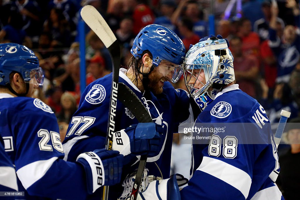 <a gi-track='captionPersonalityLinkClicked' href=/galleries/search?phrase=Victor+Hedman&family=editorial&specificpeople=4784238 ng-click='$event.stopPropagation()'>Victor Hedman</a> #77 of the Tampa Bay Lightning celebrates with teammate <a gi-track='captionPersonalityLinkClicked' href=/galleries/search?phrase=Andrei+Vasilevskiy+-+Ice+Hockey+Player&family=editorial&specificpeople=9594320 ng-click='$event.stopPropagation()'>Andrei Vasilevskiy</a> #88 after defeating the Chicago Blackhawks 4 to 3 in Game Two of the 2015 NHL Stanley Cup Final at Amalie Arena on June 6, 2015 in Tampa, Florida.