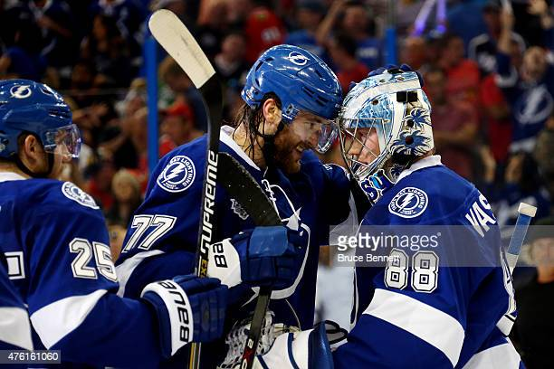 Victor Hedman of the Tampa Bay Lightning celebrates with teammate Andrei Vasilevskiy after defeating the Chicago Blackhawks 4 to 3 in Game Two of the...