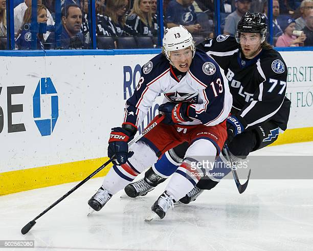Victor Hedman of the Tampa Bay Lightning chases Cam Atkinson of the Columbus Blue Jackets during the second period at the Amalie Arena on December 26...