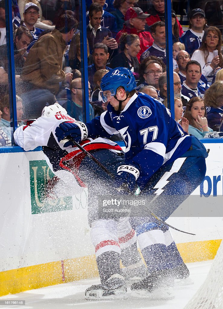 Victor Hedman #77 of the Tampa Bay Lightning checks a Washington Capitals player during the second period of the game at the Tampa Bay Times Forum on February 14, 2013 in Tampa, Florida.
