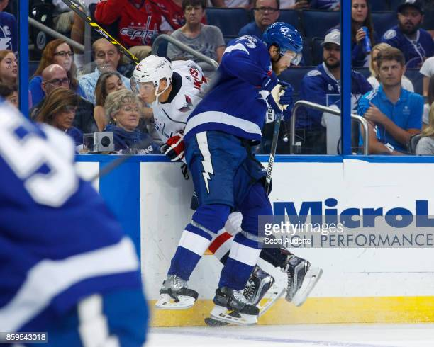 Victor Hedman of the Tampa Bay Lightning checks Andre Burakovsky of the Washington Capitals during the second period at Amalie Arena on October 9...