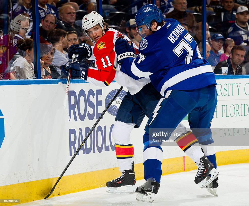 <a gi-track='captionPersonalityLinkClicked' href=/galleries/search?phrase=Victor+Hedman&family=editorial&specificpeople=4784238 ng-click='$event.stopPropagation()'>Victor Hedman</a> #77 of the Tampa Bay Lightning checks <a gi-track='captionPersonalityLinkClicked' href=/galleries/search?phrase=Jonathan+Huberdeau&family=editorial&specificpeople=7144196 ng-click='$event.stopPropagation()'>Jonathan Huberdeau</a> #11 of the Florida Panthers during the second period of the game at the Tampa Bay Times Forum on April 27, 2013 in Tampa, Florida.