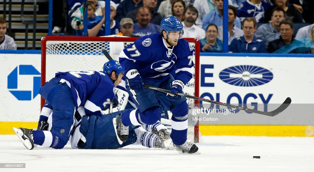 <a gi-track='captionPersonalityLinkClicked' href=/galleries/search?phrase=Victor+Hedman&family=editorial&specificpeople=4784238 ng-click='$event.stopPropagation()'>Victor Hedman</a> #77 of the Tampa Bay Lightning collects a rebound as <a gi-track='captionPersonalityLinkClicked' href=/galleries/search?phrase=Eric+Brewer&family=editorial&specificpeople=202144 ng-click='$event.stopPropagation()'>Eric Brewer</a> #2 defends against the Toronto Maple Leafs at the Tampa Bay Times Forum on April 8, 2014 in Tampa, Florida.