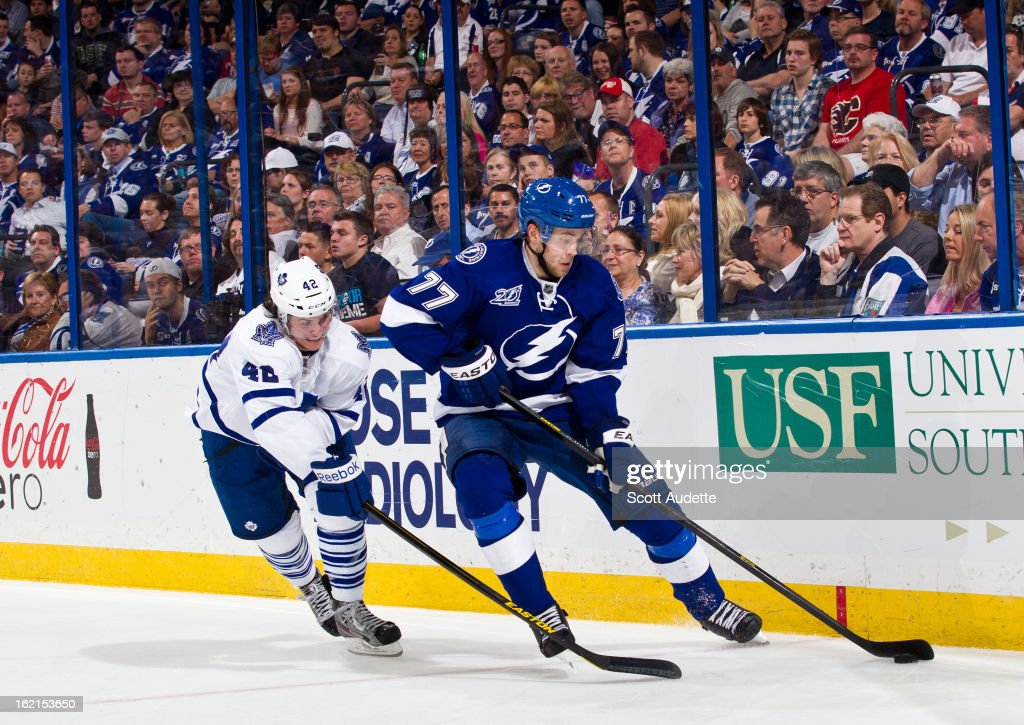 <a gi-track='captionPersonalityLinkClicked' href=/galleries/search?phrase=Victor+Hedman&family=editorial&specificpeople=4784238 ng-click='$event.stopPropagation()'>Victor Hedman</a> #77 of the Tampa Bay Lightning controls the puck in front of <a gi-track='captionPersonalityLinkClicked' href=/galleries/search?phrase=Tyler+Bozak&family=editorial&specificpeople=6183313 ng-click='$event.stopPropagation()'>Tyler Bozak</a> #42 of the Toronto Maple Leafs during the third period of the game at the Tampa Bay Times Forum on February 19, 2013 in Tampa, Florida.