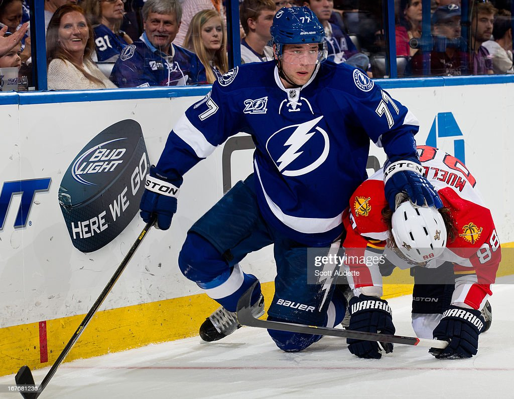 <a gi-track='captionPersonalityLinkClicked' href=/galleries/search?phrase=Victor+Hedman&family=editorial&specificpeople=4784238 ng-click='$event.stopPropagation()'>Victor Hedman</a> #77 of the Tampa Bay Lightning fights for position with Peter Mueller #88 of the Florida Panthers during the second period of the game at the Tampa Bay Times Forum on April 27, 2013 in Tampa, Florida.
