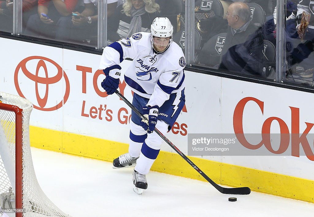 Victor Hedman #77 of the Tampa Bay Lightning makes a pass from behind the net in the second period during the NHL game against the Los Angeles Kings at Staples Center on November 19, 2013 in Los Angeles, California. The Kings defeated the Lightning 5-2.