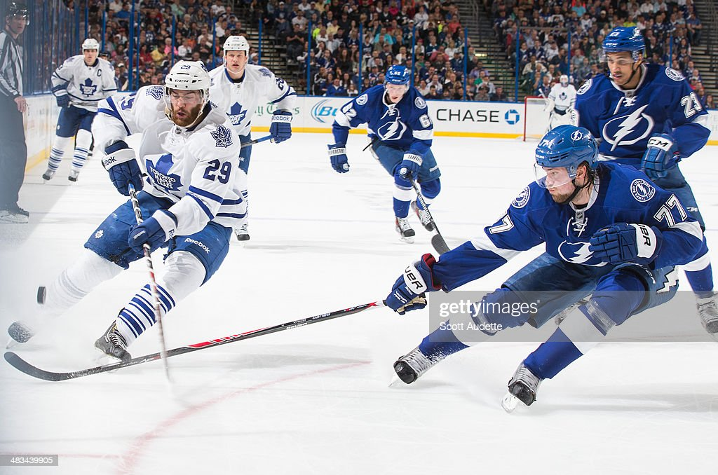 <a gi-track='captionPersonalityLinkClicked' href=/galleries/search?phrase=Victor+Hedman&family=editorial&specificpeople=4784238 ng-click='$event.stopPropagation()'>Victor Hedman</a> #77 of the Tampa Bay Lightning poke checks the puck away from <a gi-track='captionPersonalityLinkClicked' href=/galleries/search?phrase=Jerry+D%27Amigo&family=editorial&specificpeople=4782925 ng-click='$event.stopPropagation()'>Jerry D'Amigo</a> #29 of the Toronto Maple Leafs during the second period at the Tampa Bay Times Forum on April 8, 2014 in Tampa, Florida.