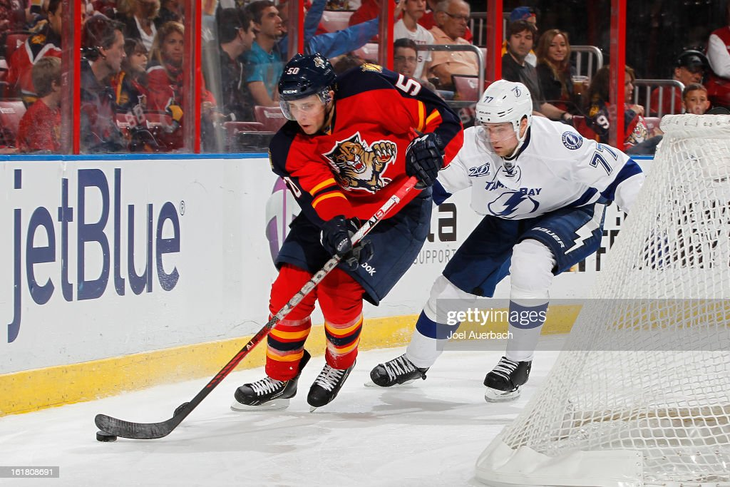 Victor Hedman #77 of the Tampa Bay Lightning pursues Drew Shore #50 of the Florida Panthers at the BB&T Center on February 16, 2013 in Sunrise, Florida. The Lightning defeated the Panthers 6-5 in overtime.