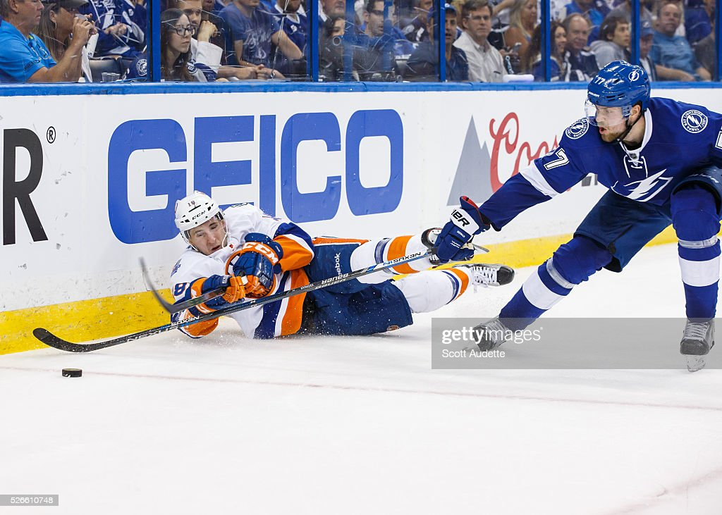 <a gi-track='captionPersonalityLinkClicked' href=/galleries/search?phrase=Victor+Hedman&family=editorial&specificpeople=4784238 ng-click='$event.stopPropagation()'>Victor Hedman</a> #77 of the Tampa Bay Lightning reaches for the puck against <a gi-track='captionPersonalityLinkClicked' href=/galleries/search?phrase=Ryan+Strome&family=editorial&specificpeople=6381535 ng-click='$event.stopPropagation()'>Ryan Strome</a> #18 of the New York Islanders during the second period of Game Two of the Eastern Conference Second Round in the 2016 NHL Stanley Cup Playoffs at the Amalie Arena on April 30, 2016 in Tampa, Florida.